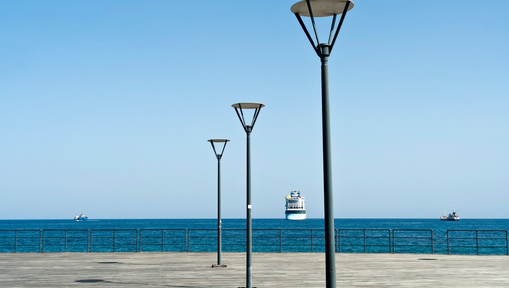 Empty,Wooden,Sea,Pier,With,Three,Street,Lamps,In,Front